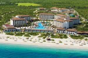 how far is Secrets Playa Mujeres from Cancun Airport