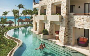How far is Secrets Akumal from Cancun Airport