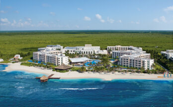 How far is Secrets Silversands from Cancun Airport