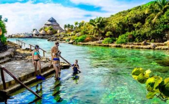 How far is Xcaret from Cancun